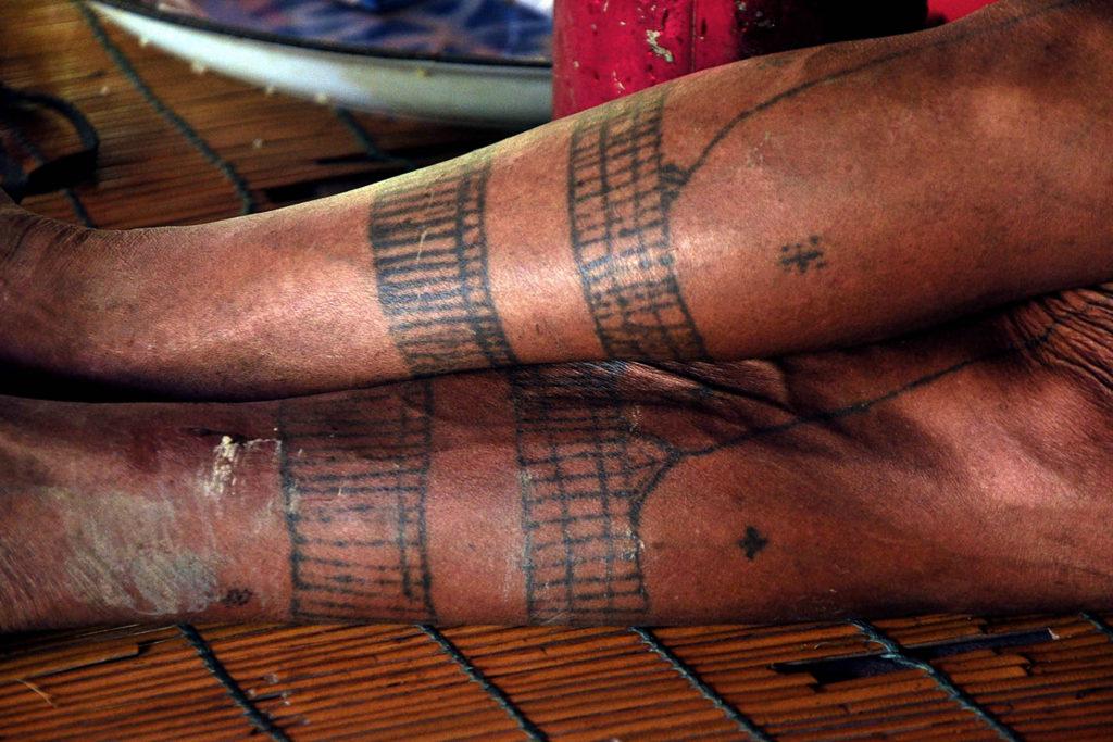 Mandara tatouage homme fleur éco-tourisme indonésie